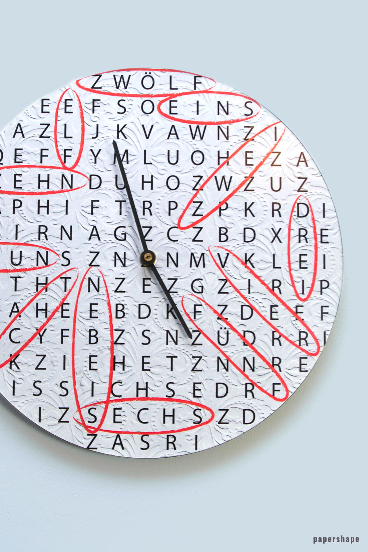 upcycling idea: wall clock from an old vinyl record and crossword puzzles. free template from #papershape